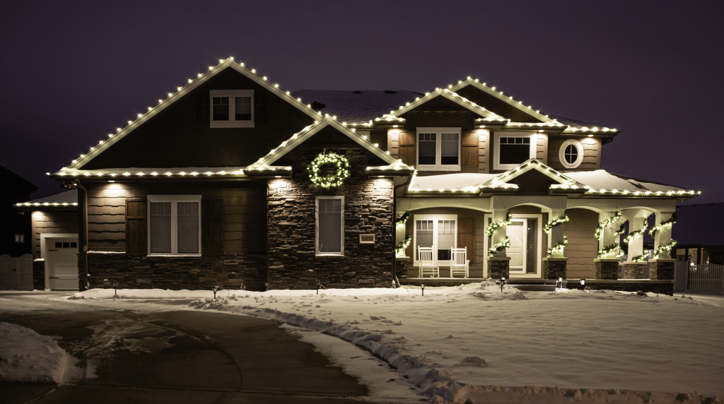 An Image of a decorated holiday lighting home