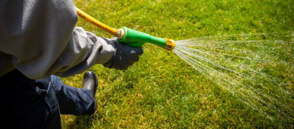 This is an image of a man performing liquid aeration